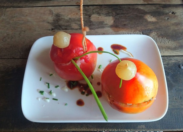 Stuffed tomatoes filled with sautéed vegetables and Cuban cheese at Giroud