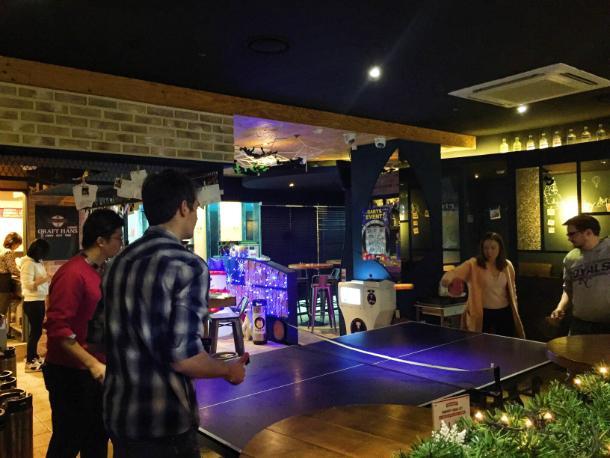 Friends Playing Ping Pong at a Korea Bar  |  Danielle Smith