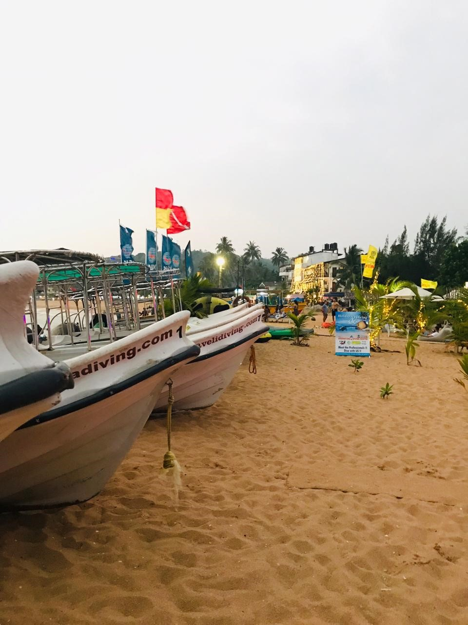Boats docked by the beach-side