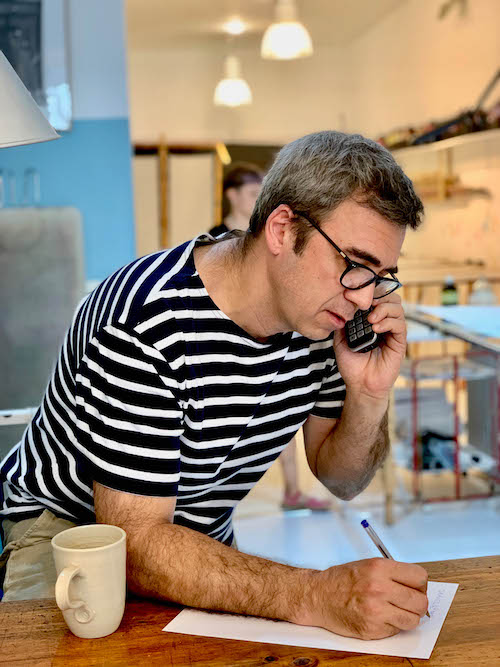Claudio Mendez, head owner of the shop, Lola Fonseca, taking a custom order by phone during an interview on July 24, 2019 in Madrid, Spain. | Bertha Smith